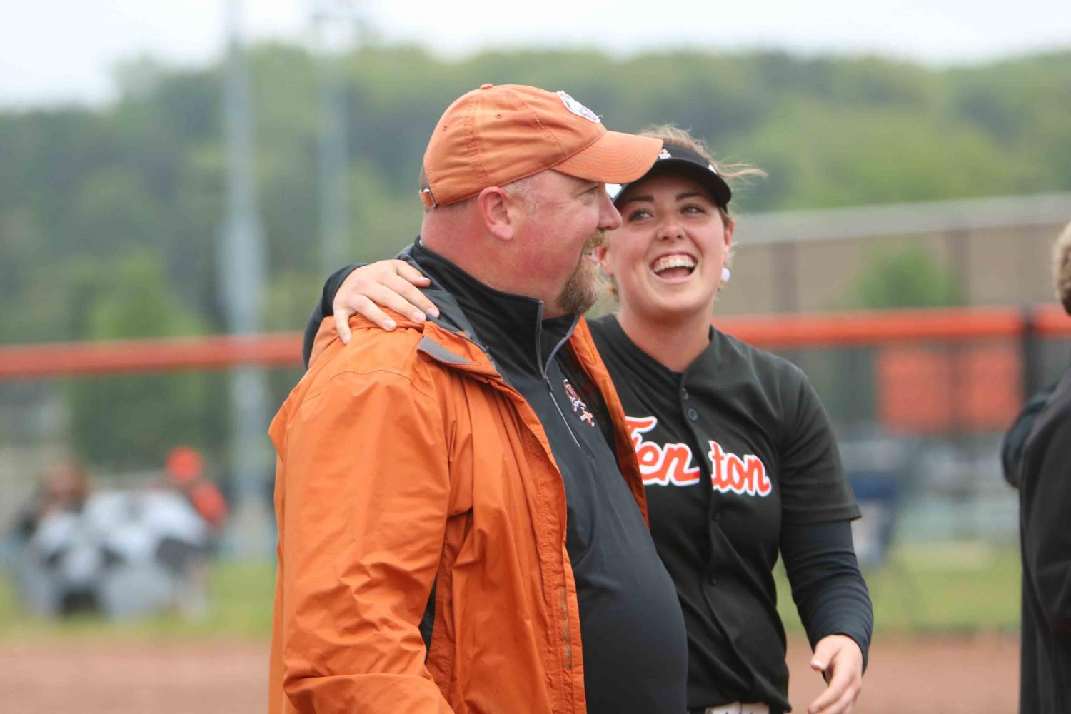 During her last home game, senior Meaghan McArdle laughs along with her dad. This years varsity team had a total of 5 seniors graduating.