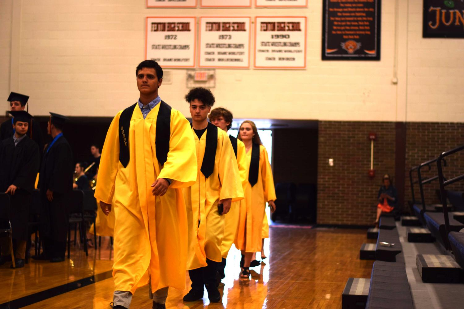Junior Matthew Sullivan escorts his fellow Honor Guard members at the beginning of the Senior's Honor Assembly held during SRT.