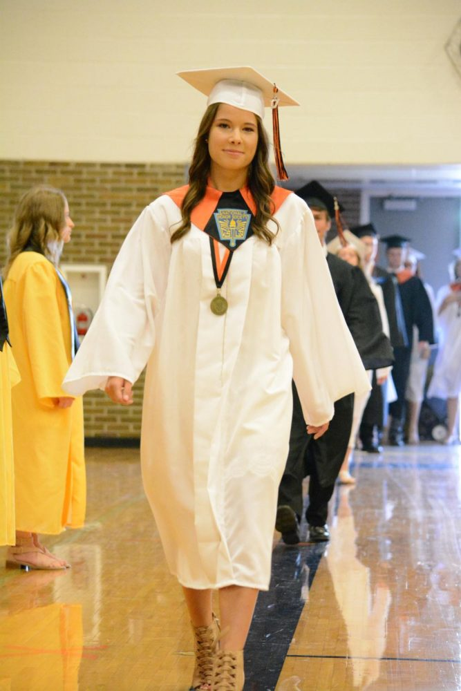 Senior Elise Delecki walks into graduation. The seniors celebrated their completion of high school with commencement on June 11.