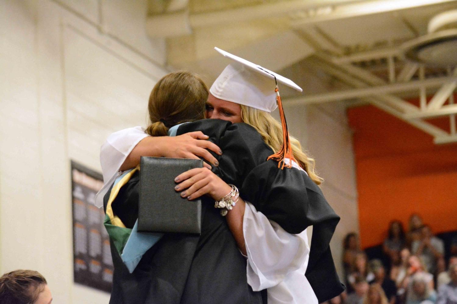After receiving her diploma, senior Maddie Welch hugs her mom as they both tear up. This years graduating class had a total of 272 seniors who were apart of the graduation ceremony on Sunday.
