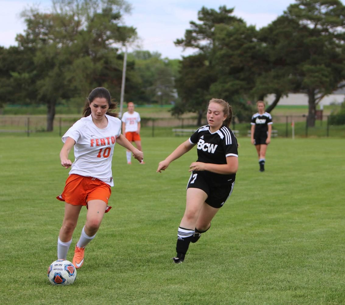Sophomore Andrea Keoshian, dribbles the ball down the soccer field during their game last week. Keoshian along with the rest of the JV girls soccer team won against the team from Bay City with a final score of 1-0.
