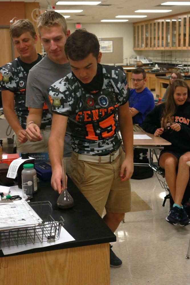 Jared Peart participated in Mr. Kasak's chemistry lab feeling the heat that occurs during a chemical reaction.