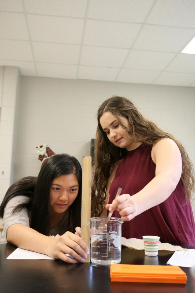 Measuring the correct amount of liquids seniors Grace Xiong and Megan Deming complete an enzyme lab. The enzyme lab is one of many that Anatomy classes complete throughout the year.