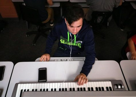 During his 1A Music Technology class, junior Jacob Kinser creates a tracks using the midi controllers. During Music Technology students use both Garage Band and Logic to create music.