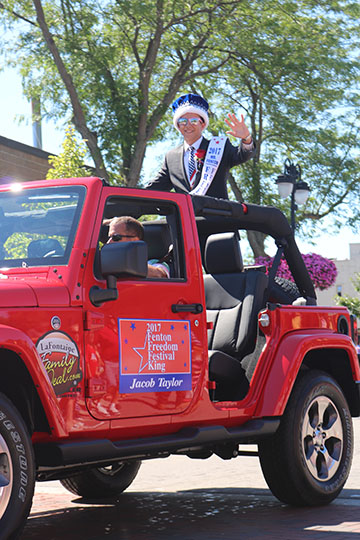Senior Jacob Taylor riding in the Fourth of July parade. Taylor was the Freedom Fest king.