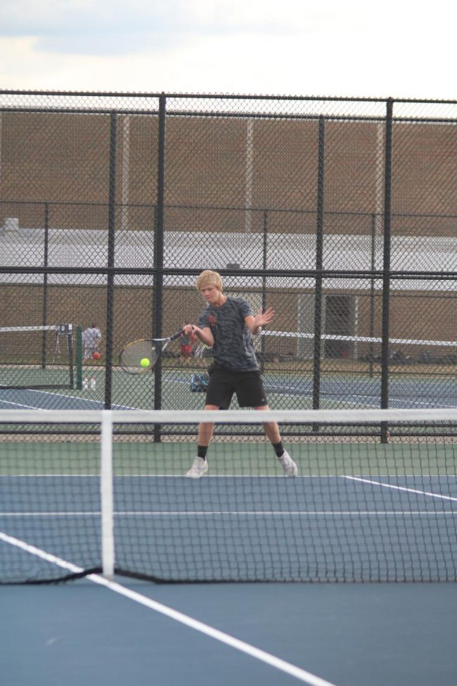 Sophomore Jack Gundry at his tennis match against Owosso. Jack's doubles partner is Bradley Trecha and together the team won 8-0.