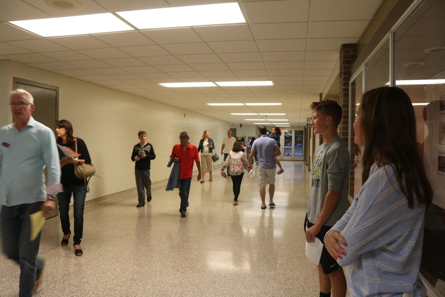 Juniors Nolan Day and Sabrina Hall observe parents as they follow their child's schedule for parent night.