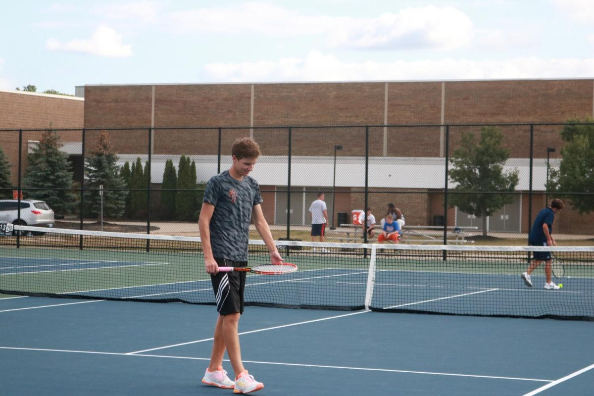 After scoring a point, senior Baylor Hamiliton feels good about the rest of the game. The Fenton boys tennis team did well during their match against Owossow high school.