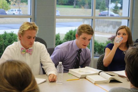 Along with their other IB History classmates, juniors Noah Maier, Evan Bartow and Sabrina Hall participate in a seminar about European impact on Native Peoples.