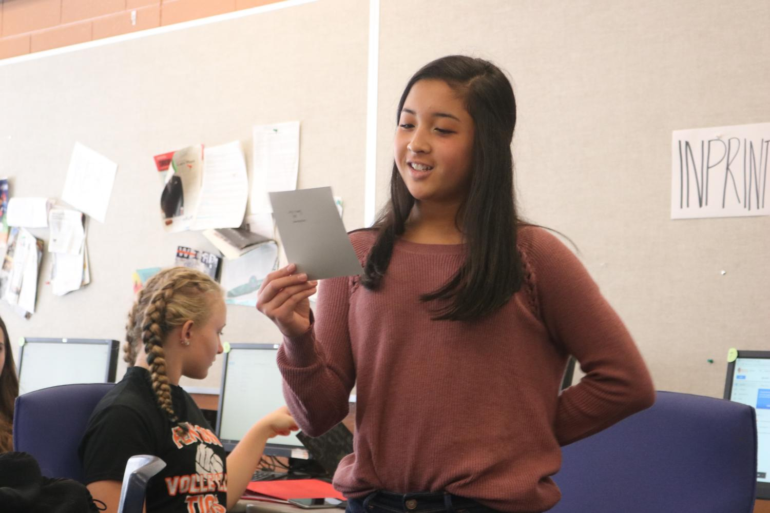 Reading a quote that keeps her motivated, freshman Lily Tiong and the rest of the InPrint staff start the year off with bonding activities.