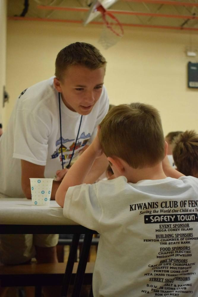 At the annual Safety Town, key club and National Honor Society members volunteer to teach little kids safety rules. Junior, Jase Brant, helped his little buddy as they ate animal crackers after doing arts and crafts together.