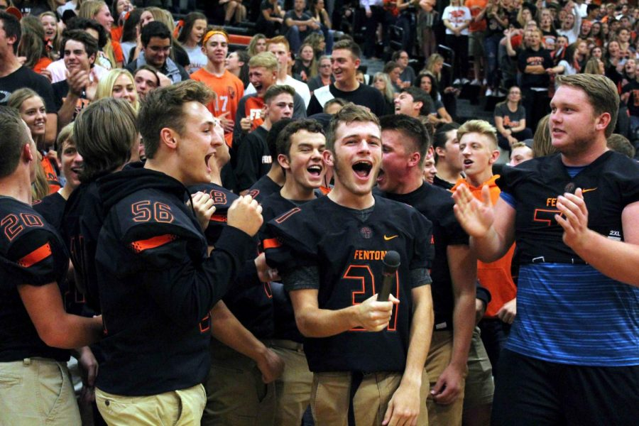 Junior Ethan Crawford holds the microphone as the juniors scream the battle cry. The juniors took third place at the pep assembly.