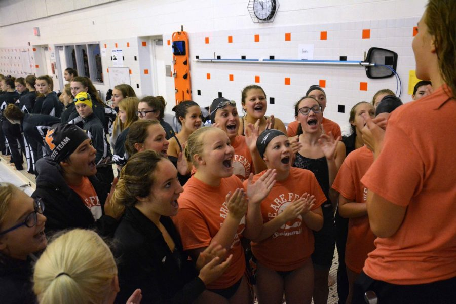 Chanting along with her teammates, freshman Catherine Haynes participates in her first Tiger Relays. Fenton hosted this years meet which included teams from all over the county.