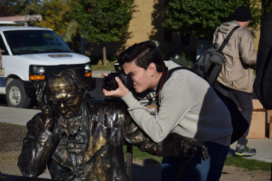 For his Desktop Publishing class, freshman Ahmad Khan takes photos in downtown Fenton. During Desktop publishing students learn the basics that will help in advanced publications classes.