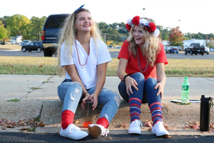 Before their last Hero's Night game of their high school career, senior, Racheal wright and Joie Raymond hang out with other classmates. Raymond and Wright planned to tailgate before the game, they cooked hot dogs and ate chips and salsa with their friends.