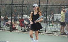 Senior Delaney Hundzinski plays on varsity boys tennis team