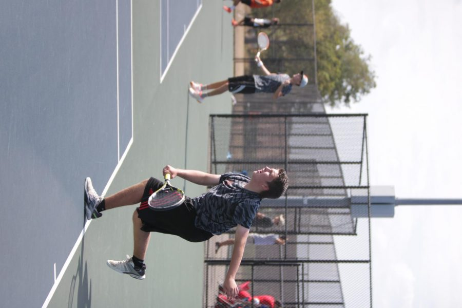 The Boy's Tennis team plays vigilantly at the Championships. the team did a fantastic job during their matches.