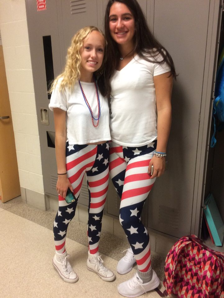 For Spirit Week, juniors Abbey Lee and Delaney Miesch wear matching USA stars and stripes leggings.  Tomorrow's theme will be Hippie Day.