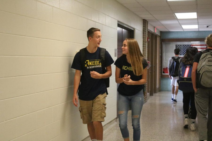 Sophomores Sam Smith and Anna Weigle walk t their next class all decked out in Michigan gear. many students supported their favorite teams on Fav Sports Day during homecoming week.