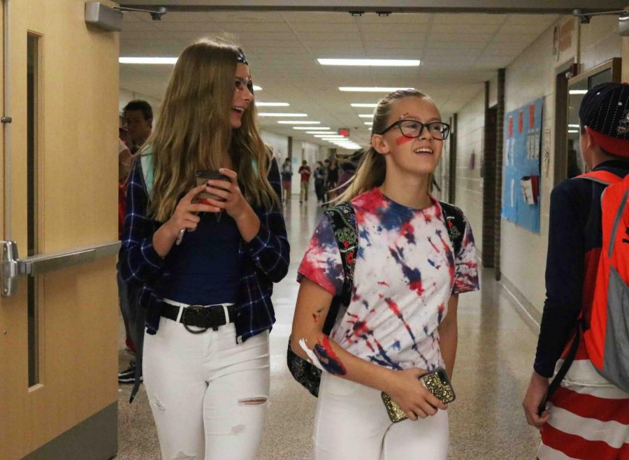Sophomores Maddy Diamond and Jaidyn Rogers hangout before school in their red, white, and blue. Supporting homecoming and the country, many students dressed up for U.S.A. Day.