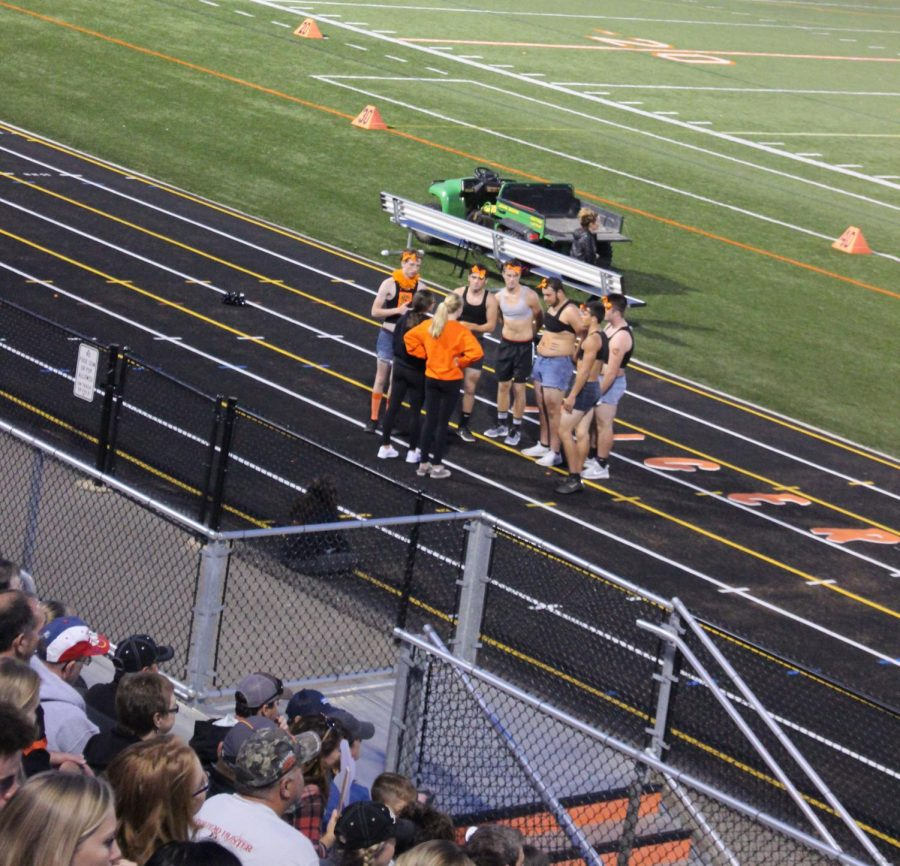 Freshman Mackenzie Durant and Taylor Wire teaching the football cheerleaders a new cheer during the powder puff game. There was a tie between Juniors and Seniors.