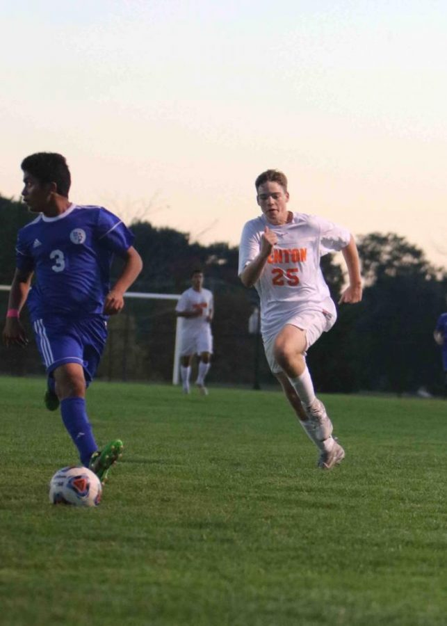 Running to catch up to the ball, junior Dalton Wagner plays against Detroit Catholic Central.