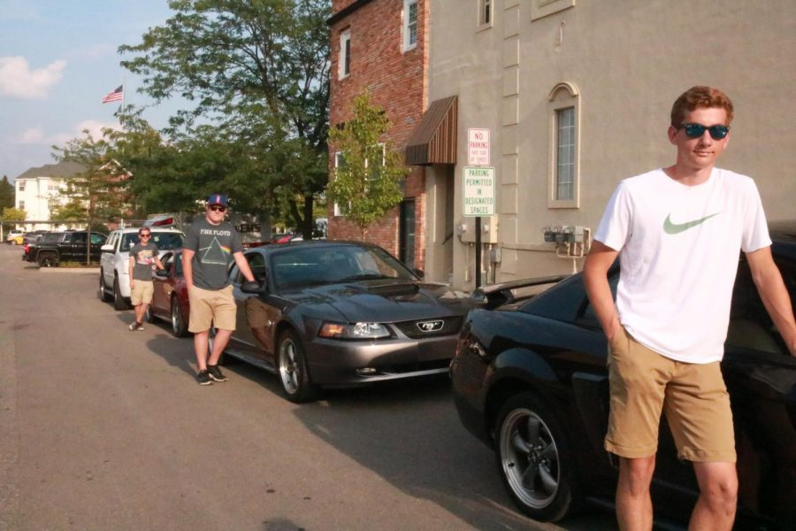 3/4 of the Stang Gang line their cars up to walk downtown at the Back to the Bricks car show. The Stang Gang consists of seniors Mathew Decker, Mathew Caligiuri, Hunter Smith, and Joe Fehir.
