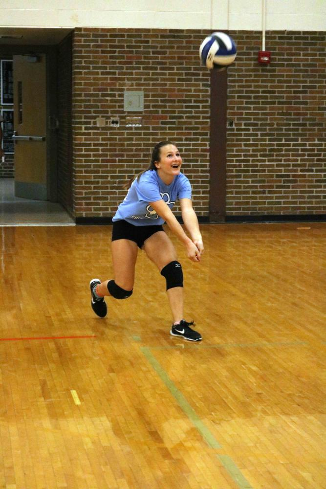 Freshman Samantha Whitten plays volleyball with her parents.  The volleyball teams play a game with their parents each year and see who wins.