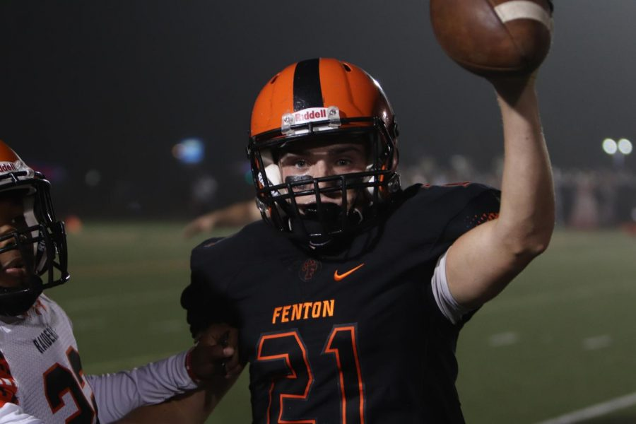 Fenton tigers win homecoming game against the Flushing raiders