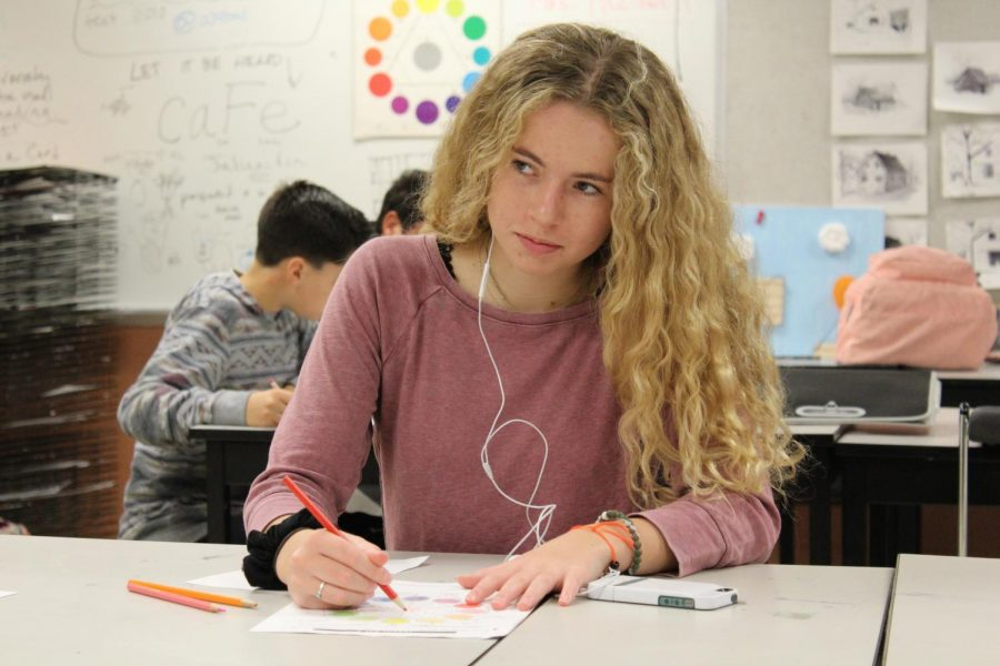 Sophomore Audrey Weir works on her project in Art  Foundation 1.