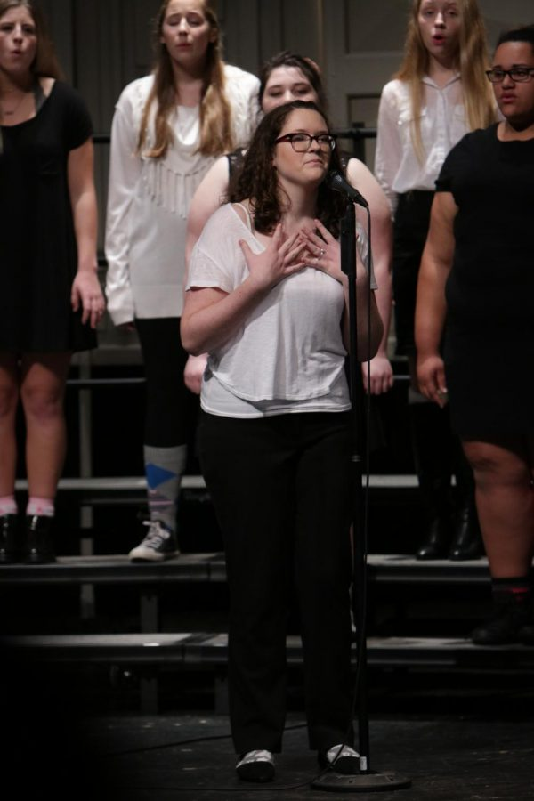 Sophomore Alyssa Keoshian preforms her solo in 'Taylor the Latte Boy' with Bella Voce on Oct. 24.