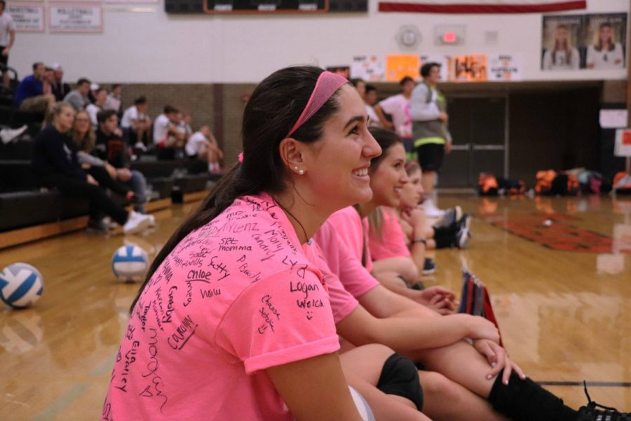On October 11, Fenton High girls volleyball team play against the boys soccer team to raise money for local families who has cancer. Junior Delaney Miesch, cheered on her teammates with a smile on her face.