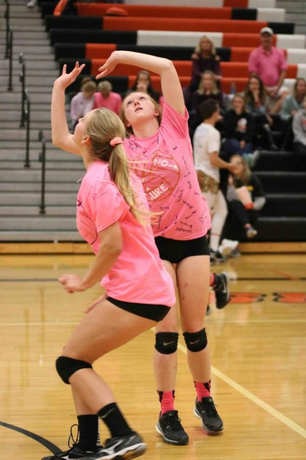 Setting the ball, senior Macyn Stevens participates in Volley for a Cure. In Volley for a Cure the boys soccer team plays against the girls volleyball team in a volleyball match to raise money for a family in Fenton with cancer.