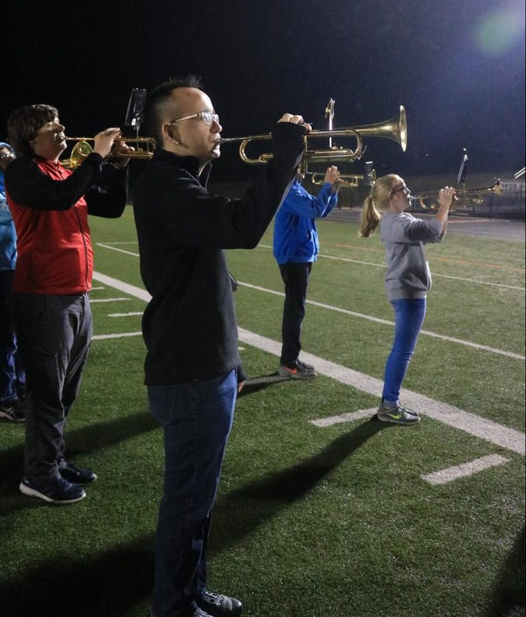 Senior Joe Amberg marches before school at 6:20 a.m. with other band members during zero hour.