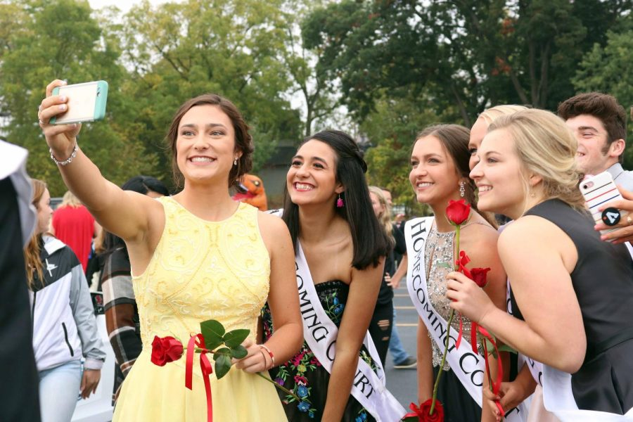 Before the Homecoming parade on Oct. 6, seniors Margaret Berry, Ariana Mansour, Julia Acton, Molly Gundry, and Molly Anderson, all of the senior queen candidates gather for a selfie.  At halftime of the football game the queen was nnounced to be Ariana Mansour, along with the king being Josh Maher.