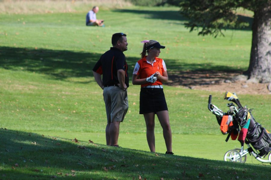 During+States+for+the+girls+golf+team+over+the+weekend%2C+senior+Molly+Gundry+talks+with+coach+Kurt+Herbstreit.+