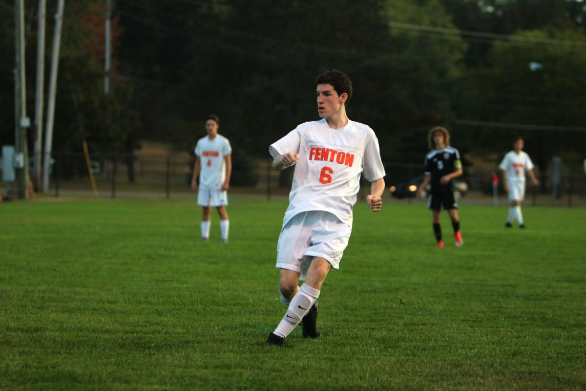 Senior  Owen O'Brien follows his teammates down the field after he passes the ball.