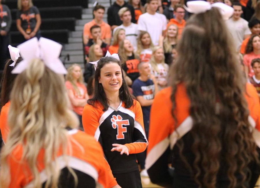 Senior Cheyenne Feltz cheers on the Fall sports teams as they were entering the auxiliary gym. Fenton High ended their homecoming week with a pep-assembly to get students hyped up for the dance on Saturday the 7.