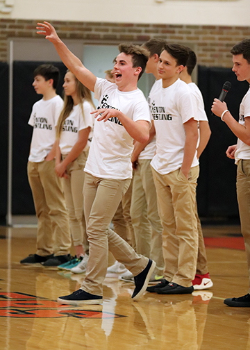 Throwing a shirt into the crowd, sophomore Brady Triola stands with his wrestling team. This is Brady's second year on the team and hopes to have a great season.