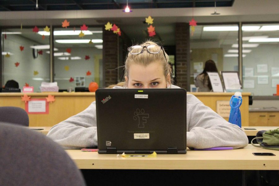 Senior Molly Anderson is focusing on getting her extended essay done. The seniors who are in the IB Diploma Program spent the entire day working to complete their extended essays.