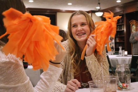 Freshman Korryn Smith has fun with a pom pom at the volleyball banquet hosted to close the season. On November 15th, the volleyball players ate dinner and exchanged gifts, having one last team bonding and celebrating an eventful and thrilling season.