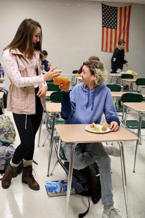 Toasting to Halloween, senior Antonio Zayas and freshman Abby Dolliver drink their apple cider as they celebrate the holiday.  Brad Jones SRT organized a Halloween party for the class and each person brought in food.
