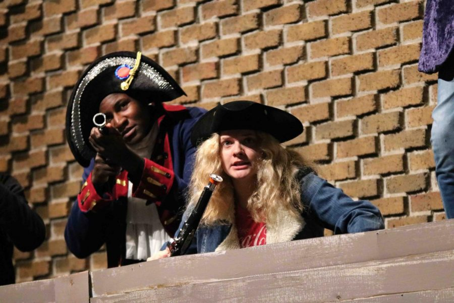 Performing in Treasure Island, senior Joie Raymond ducks for cover in a fight against the pirates. The drama department put on Treasure Island by Robert Louis Stevenson. The show was available to see for a limited time.