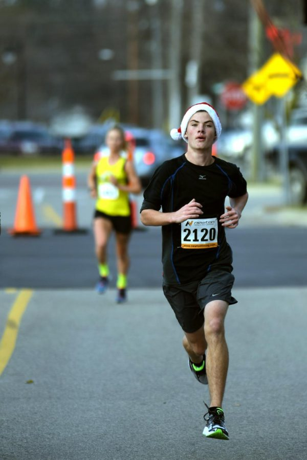 At the end of the Fenton Jingle Jog, freshman Hunter Wheeler places well against the highest tier runners in Fenton. Wheeler and three other runners from Fenton High School, Wyatt Williams, Vien Sturm, and Landon Sahouri ran the Fenton 5K Jingle Jog.