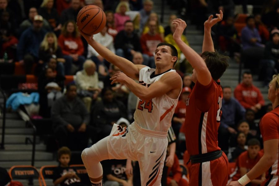 After sprinting all the way down the court senior AJ Lepage goes up for a layup. The Tigers will play against Kearsley on Dec. 15.