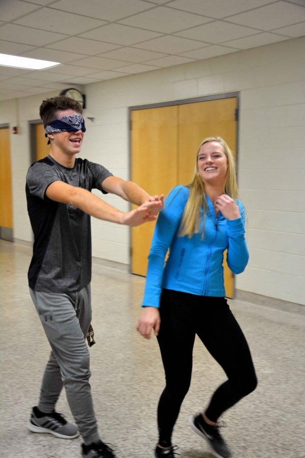 While guiding her partner down the hallway, senior Taylor Shegos doges her partner as he blindly plows down the hallway. All the Psychology classes got the chance to experience what it would be like to lose our sight and have to rely on our other senses.