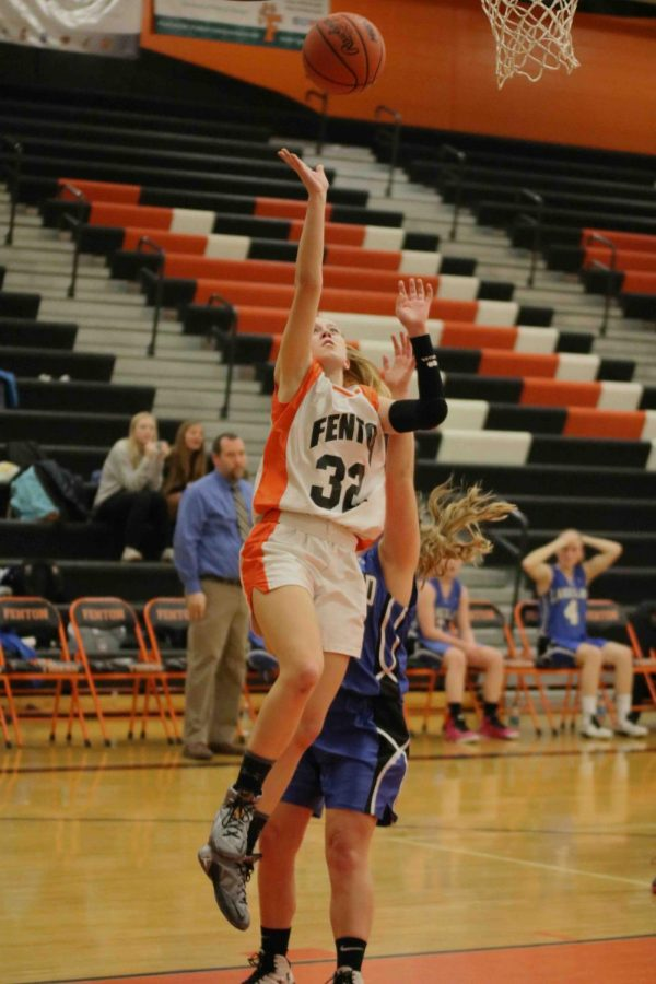 Freshman Mallory Lehmann shooting a basket for her freshman team on December 5th. The girls won against White Lake 34- 22. All of the girls Basketball team play again this Friday December 8th.