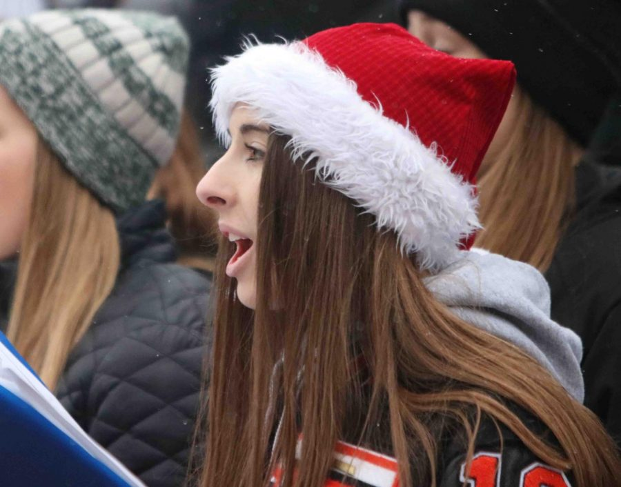 Senior Jillian Ferry singing at the Holly Dickens Festival on Dec. 9. Varsity vocals has another performance on December 21st.