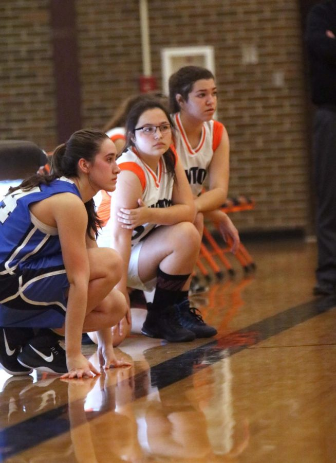 Freshman Madelynn Thomas and Jordan Wensley get ready to jump into the action of their freshman girls basketball game. They just had a talk with their coach and they are ready to do better than before.