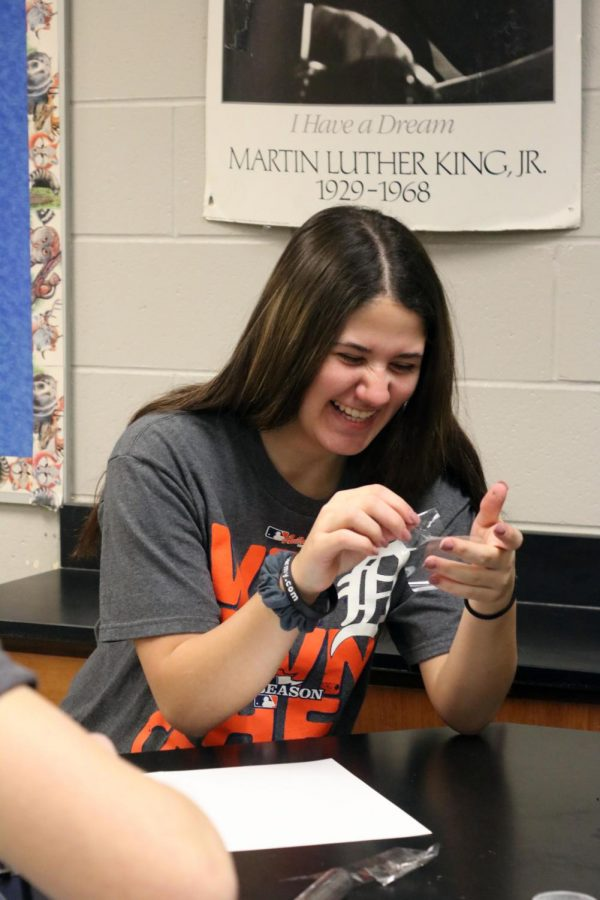 Senior Lea Bartnik participates in a forensic lab related to finger-printing.  A police officer came in to the 1B class to talk to them about the importance of finger-printing and the work that goes into it.